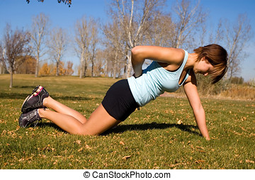 One-armed pushups - Attractive woman doing one-armed...