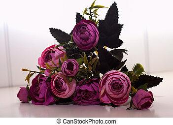 artificial bouquet of purple peonies