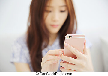one Asian woman with smart phone