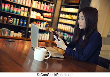 one Asian woman with smartphone