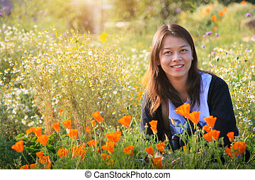 One Beautiful happy asian woman in the flowers garden