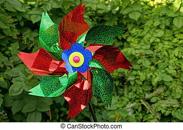 one big colored plastic toy windmill