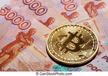 One Bitcoin on Russian rubles banknotes.