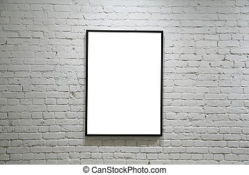 one black frame on white brick wall