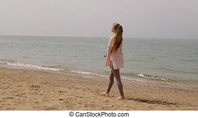 one blonde woman on the beach by the sea 2