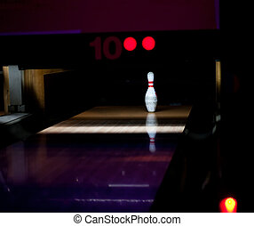 One bowl left in bowling lane