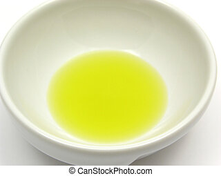 One bowl of chinaware with olive oil in a close-up view