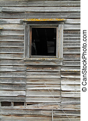 One Broken Window in a Dilapidated Brown Wooden House