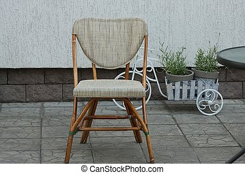 one brown wooden chair with a soft seat