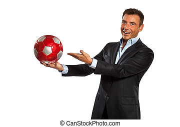 one business man holding showing a soccer ball - one...