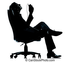 one business man listening relaxation music silhouette - one...