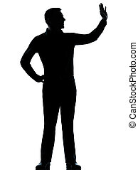 one business man saluting silhouette - one caucasian...