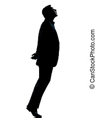one business man silhouette tiptoe looking up - one...