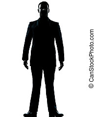 one business man standing full length silhouette
