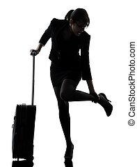 business woman traveling massaging feet silhouette