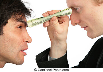 One businessman looks at another through small tube from dollar