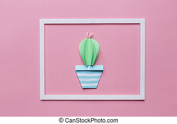 one cactus in the white frame on a pink background