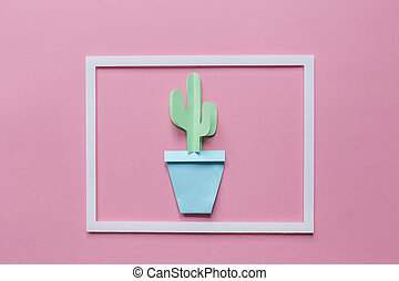 one cactus of paper in the white frame on a pink background