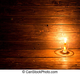 One candle on old wooden background. Christmas background