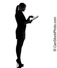 one caucasian business woman computer computing typing digital tablet in silhouette studio isolated on white background