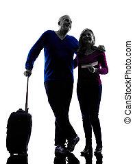 couple senior travelers traveling silhouette