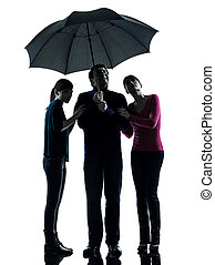 one caucasian family father mother daughter man under umbrella  danger afraid  in silhouette studio isolated on white background