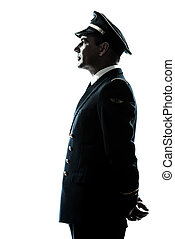 man in airline pilot uniform silhouette - one caucasian man...