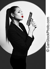 sexy detective woman holding aiming gun