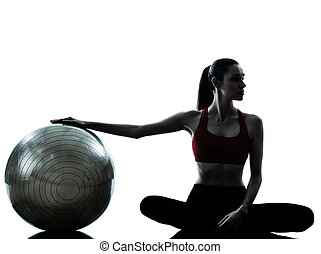 woman exercising fitness ball - one caucasian woman...