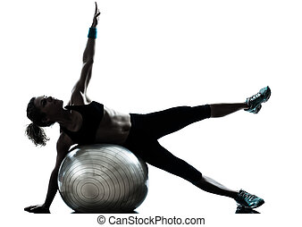 woman exercising fitness ball workout - one caucasian woman ...