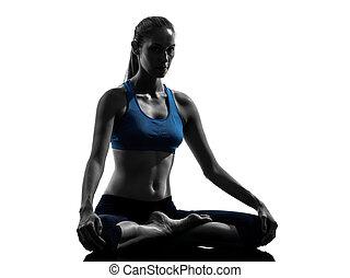 woman exercising yoga meditating - one caucasian woman ...