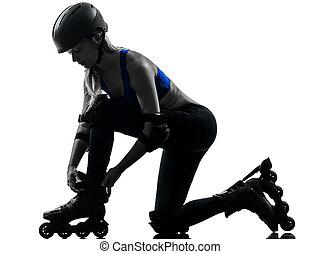 woman tying roller skates silhouette