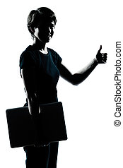 one caucasian young teenager silhouette girl holding carrying laptop computer thumb up portrait in studio cut out isolated on white background