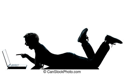 one caucasian young teenager silhouette boy girl computer computing laptop lying on front full length in studio cut out isolated on white background