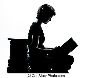 one caucasian young teenager silhouette girl reading full...