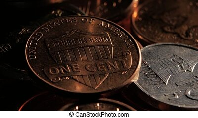 One cent is on top of the pile. Close up - Patch of light...