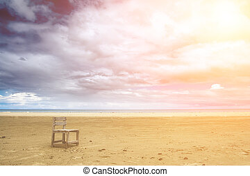 one chair on the beach - It is a lonely one chair on the...