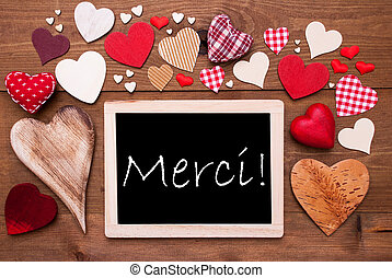 One Chalkbord, Many Red Hearts, Merci Means Thank You