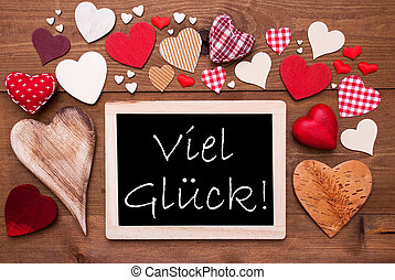 One Chalkbord, Many Red Hearts, Viel Glueck Means Good Luck...