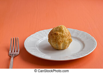 One cheese muffin on a plate