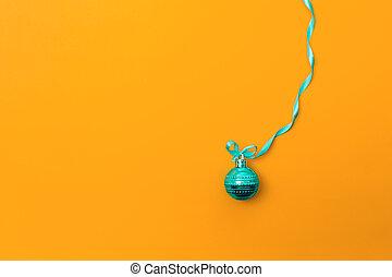 One christmas ball on orange background