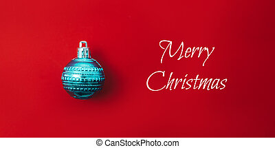 One christmas ball on red background