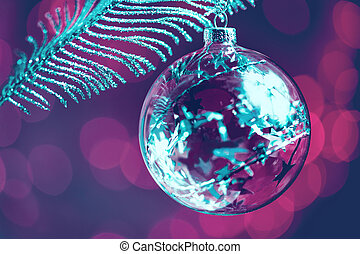 One clear glass crafted Christmas bauble closeup