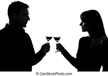 one couple man and woman drinking red wine toasting