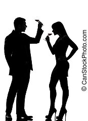 one couple man and woman drinking tasting red wine - one...