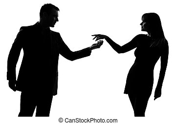 one couple man holding out inviting hand in hand woman - one...
