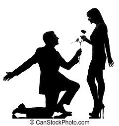one caucasian lovers couple man kneeling offering rose flower and woman in studio silhouette isolated on white background