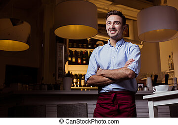 One day of waiter's life - Young, smiled waiter in...