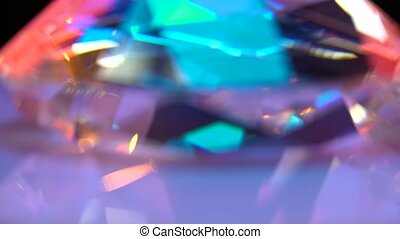 One diamond turns and shimmers in different colors
