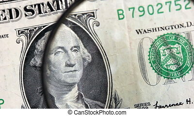 One dollar banknote identification with magnifying glass